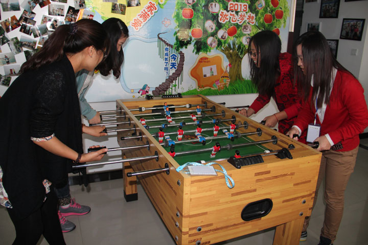 We playing foosball in the spare time welcome you join us